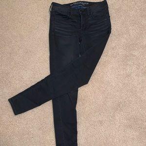 skinny black denim jeans by American Eagle